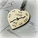 Love me, Love me not - YES / NO bronze necklace